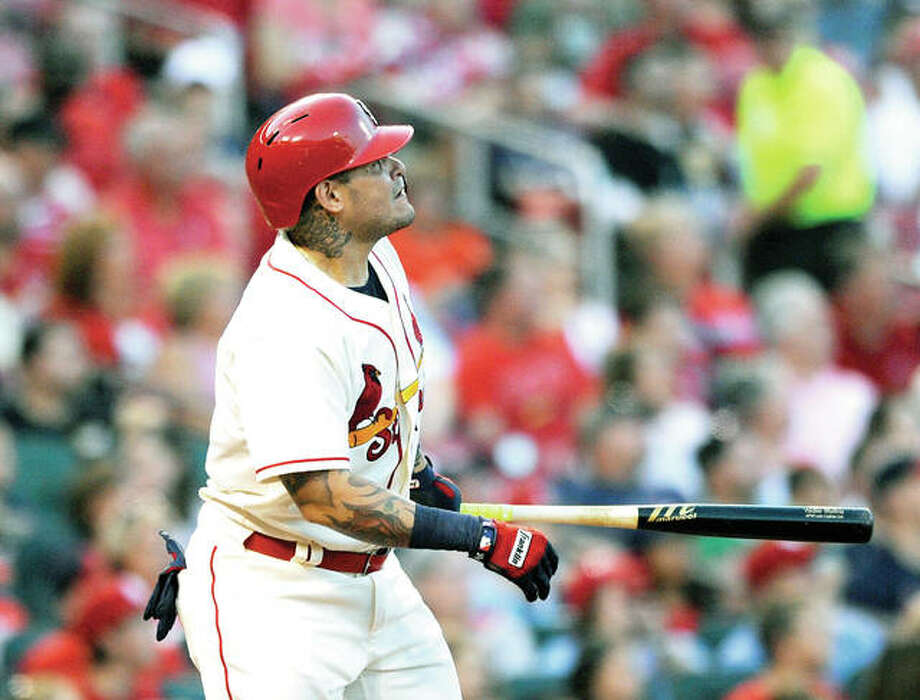 The Cardinals' Yadier Molina watches a two-run home run against the Pirates Saturday at Busch Stadium.