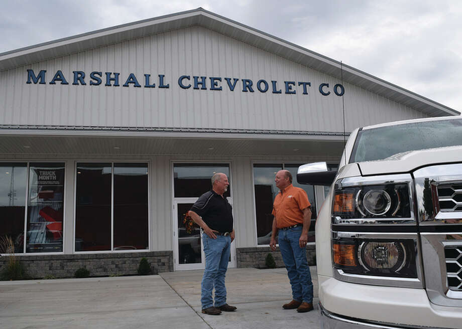 Marshall Chevrolet's co-owners Jay (left) and Paul Rueter will hold a grand reopening Thursday of the Winchester dealership.