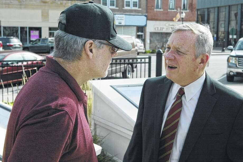 Army veteran Rob Stampf of Jacksonville talks about Veterans Administration funding with U.S. Sen. Dick Durbin during the senator's stop in town Monday. Photo: Nick Draper | Journal-Courier