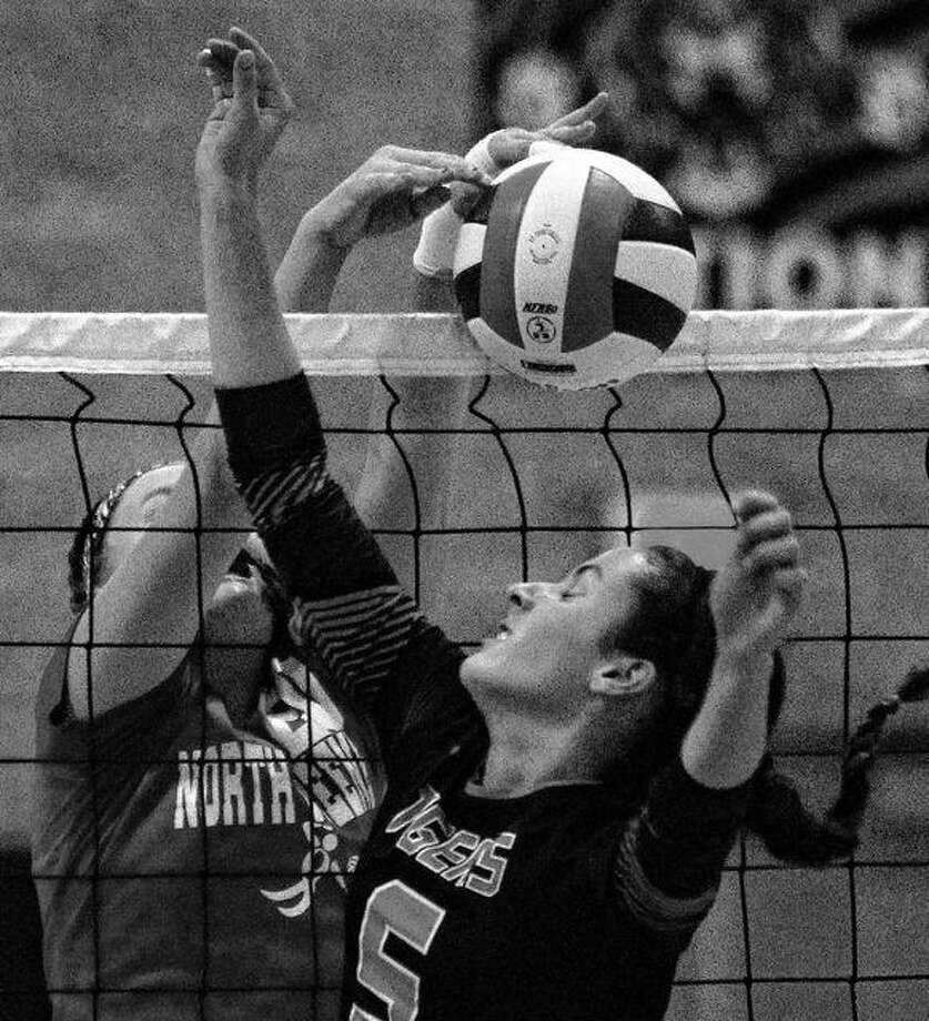 Beardstown's Hillary McGill battles for a point at the net during a match against North Greene in Beardstown Tuesday night. Photo: Dennis Mathes | Journal-Courier