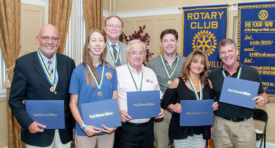 Paul Harris Fellow award recipients include Mark Tierno (from left), Kori Daniels, Doug Rahn, Ralph Gonzalez, Steven Varble, Antonia Alfano and Jess Spradlin. Sara Littleton-Watret was also named a Paul Harris Fellow.
