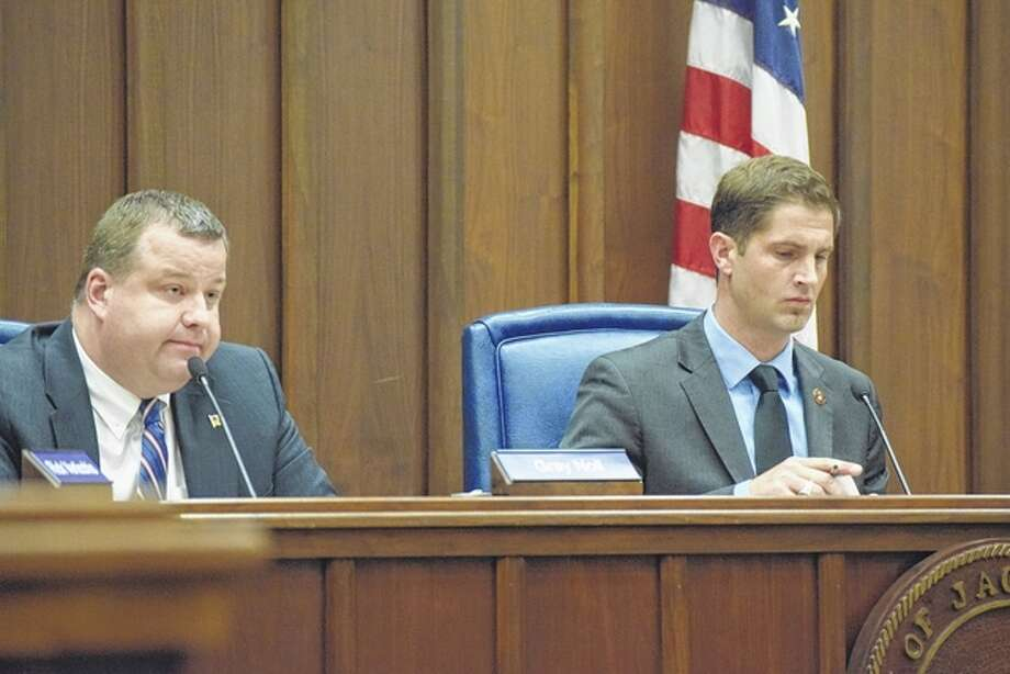 Morgan County State's Attorney Gray Noll (left) and candidate Tyson Manker answered questions Wednesday night at the Morgan County League of Women Voters candidates' forum at the Jacksonville Municipal Building. Photo: Samantha McDaniel-Ogletree | Journal-Courier