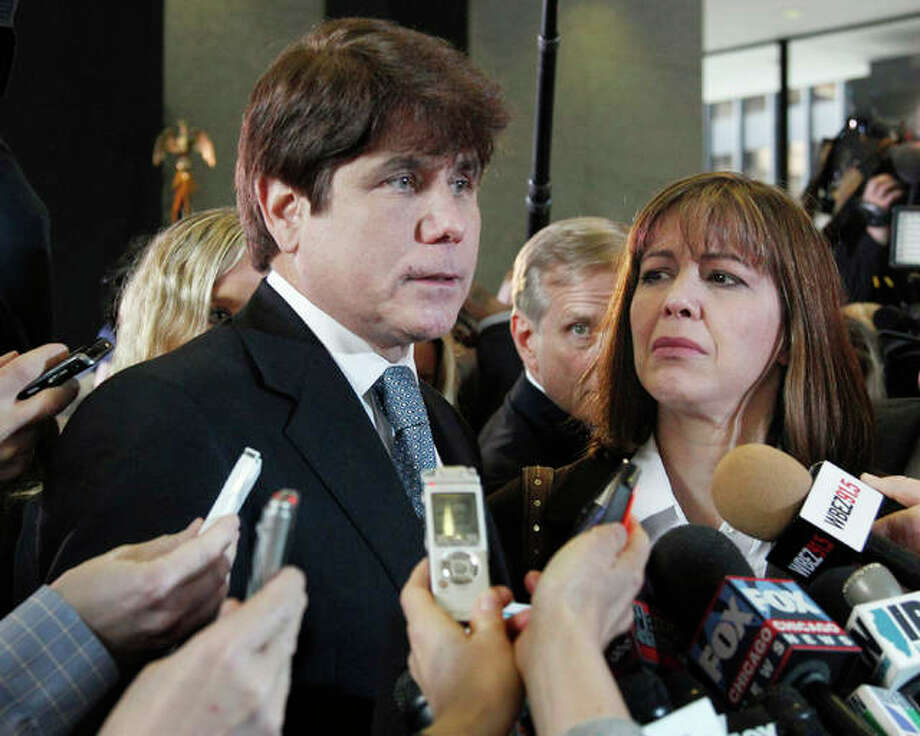 In this Dec. 7, 2011 file photo, former Illinois Gov. Rod Blagojevich, left, speaks to reporters as his wife, Patti, listens at the federal building in Chicago. Blagojevich said he now spends his time sweeping and mopping floors while serving a federal prison sentence after corruption convictions. Blagojevich said in an interview released Monday, Sept. 11, 2017, from a Colorado prison, that he still maintains his innocence and hopes to make another appeal to the U.S. Supreme Court. The 60-year-old is 5 ½ years into a 14-year sentence. Photo: AP Photo/M. Spencer Green, File