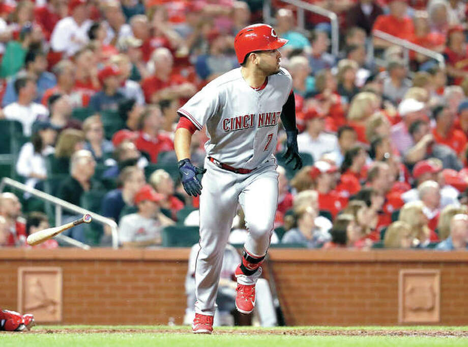 The Reds' Eugenio Suarez watches his grand slam leave the ballpark in the fifth inning of Wednesday night's game against the Cardinals at Busch Stadium. Photo: AP