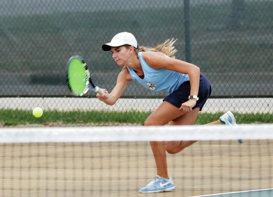 Jersey's Libby Roth rushes to return a shot during her No. 2 double's match against Civic Memorial on Wednesday in Jerseyville. Roth won her No. 3 singles match before losing in doubles in a 5-4 Panthers dual victory.