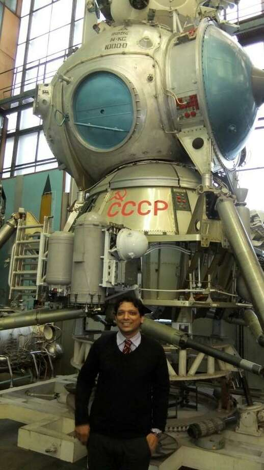 Asif Siddiqi, a space historian and professor from Fordham University, stands in front of a Soviet-area space craft. Photo: Contributed