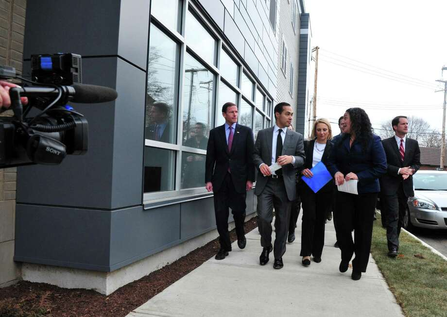 Bridgeport Neighborhood Trust held a ribbon cutting ceremony to celebrate the opening of the new Milestone Apartments on Stratford Avenue in Bridgeport in 2016. HUD Secretary Julian Castro was on hand to attend the ribbon cutting along with Senator Richard Blumenthal, Senator Chris Murphy, Congressman Jim Himes, Mayor Joe Ganim and other town and state officials. Photo: Christian Abraham / Hearst Connecticut Media / Connecticut Post
