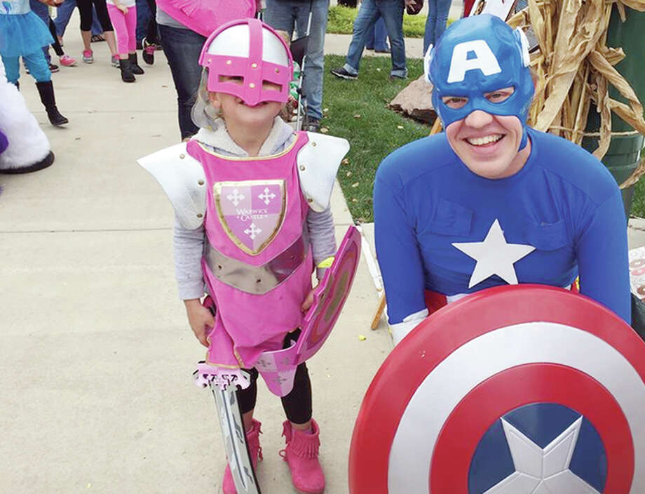 A knight in pink meets Captain America during the 2015 Jacksonville Main Street Pumpkin Festival. This year's festival starts at 11 a.m. Saturday on the downtown Jacksonville square. Photo: Submitted Photo