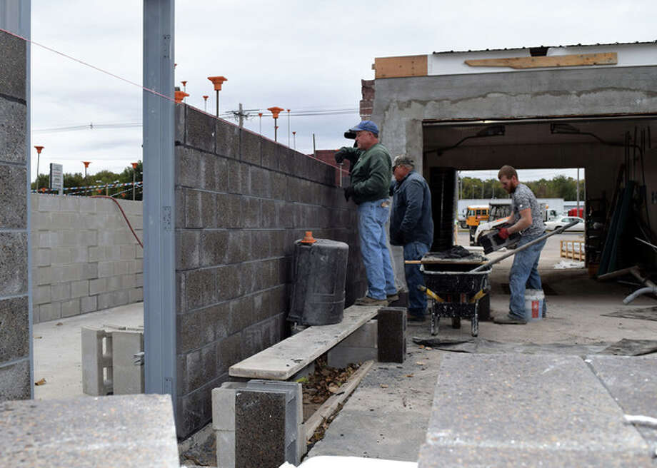 Bricklayers from Lotz Masonry of Jacksonville place concrete blocks Wednesday for Baywash's new automatic car washing units on West Morton Avenue. The 30-year-old car wash is being remodeled and should reopen by the end of the year, according to its owners. Photo: Greg Olson | Journal-Courier