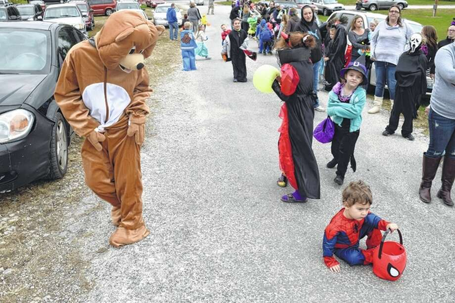 This bear and young Spider-Man were among those who waited in a long line of children and parents at the Safe Halloween for Kids event Thursday.