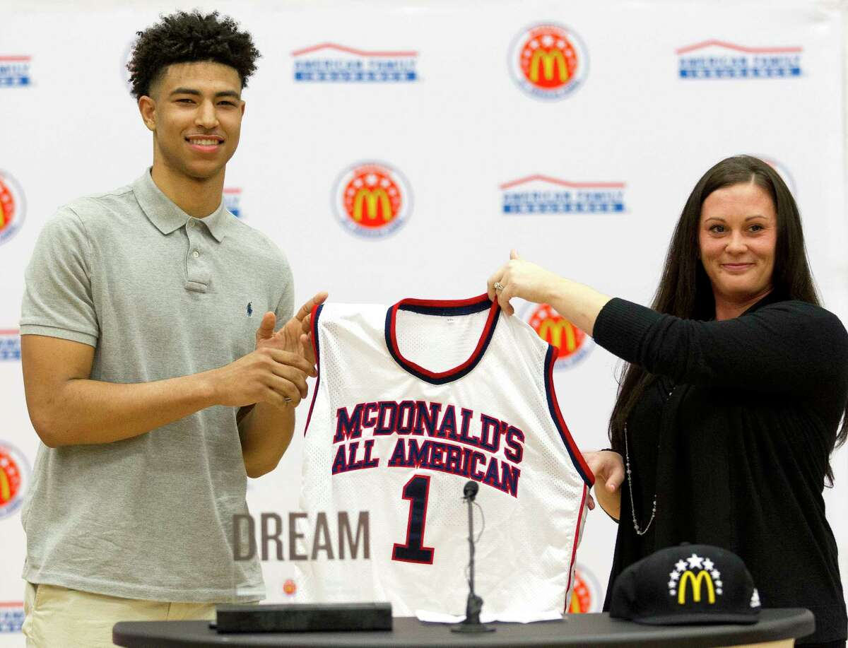 College Park's Quentin Grimes is presented with his McDonald's All-American jersey during a ceremony at College Park High School, Friday, Feb. 9, 2018, in The Woodlands. The Kansas commit, who won the Guy V. Lewis award given to the top player in Greater Houston, is the first basketball player in Conroe ISD history to earn a selection to McDonald's All-American Game. Grimes joins three other standout players from the Houston area on All-American rosters. Fort Bend TravisÂ?' Queen Egbo, Cypress Woods post Cate Reese and Barbers Hill forward Charli Collier were selected to join the girls rosters.