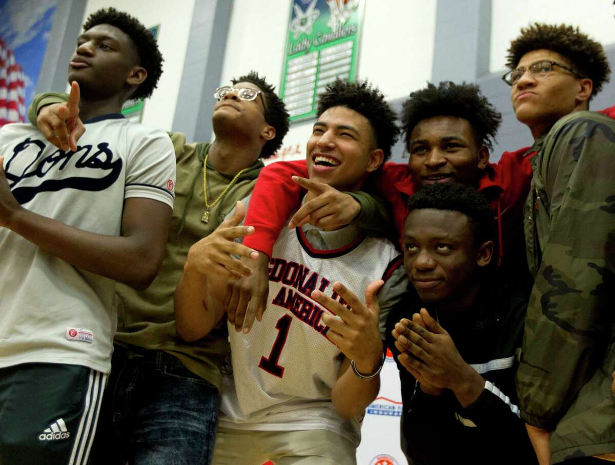 College Park's Quentin Grimes poses for a photo with teammates after being presented with his McDonald's All-American jersey during a ceremony at College Park High School, Friday, Feb. 9, 2018, in The Woodlands. The Kansas commit, who won the Guy V. Lewis award given to the top player in Greater Houston, is the first basketball player in Conroe ISD history to earn a selection to McDonald's All-American Game. Grimes joins three other standout players from the Houston area on All-American rosters. Fort Bend TravisÂ?' Queen Egbo, Cypress Woods post Cate Reese and Barbers Hill forward Charli Collier were selected to join the girls rosters.