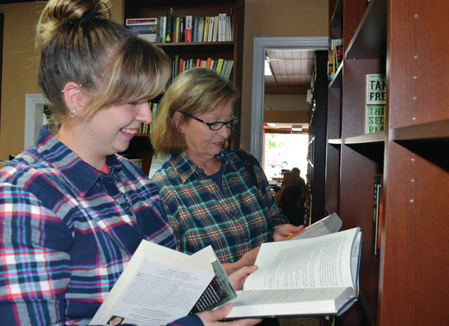 Phyllis Rowley of Kingman, Kansas, and Kassidy Oakman of Witchita, Kansas, look over the selection at Our Town Books. Photo: Nick Draper | Journal-Courier