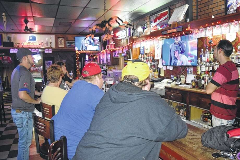 Chicago Cub fans watch Game 1 of the World Series Tuesday night between the Cubs and the Cleveland Indians at Bill's West State Tavern in downtown Jacksonville. Photo: Greg Olson | Journal-Courier
