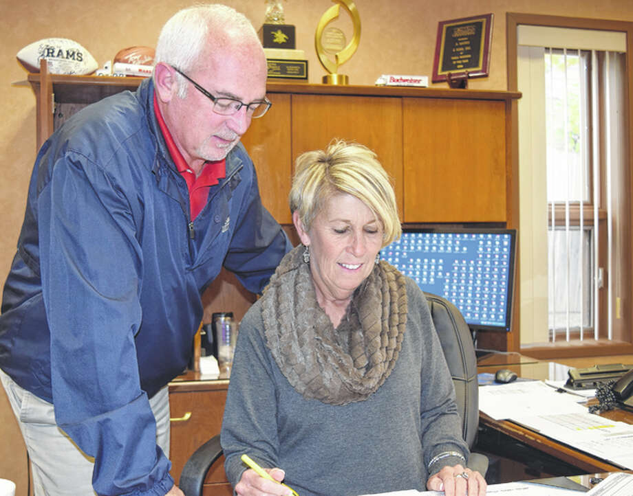 Sales manager Mickey Marks and Susan Gaudio of A. Gaudio & Sons look over documents Tuesday at the Jacksonville beer distributorship. Photo: Nick Draper | Journal-Courier