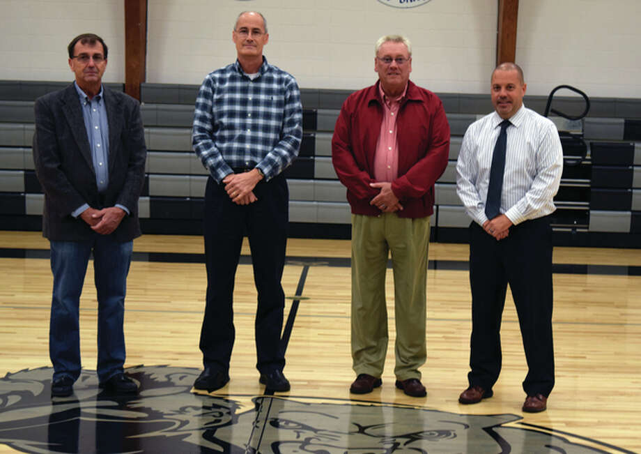 Jim Freeman (left), of Illinois Rural Electic, Gary Westermeyer of Westermeyer Industries, Ron Rose of the Bank of Bluffs and Bluffs School Superintendent Kevin Blankenship stand in the Bluffs school gym Thursday for the dedication of new scoreboards. Each organization donated funds to cover the cost of the scoreboards. Photo: Samantha McDaniel-Ogletree | Journal-Courier