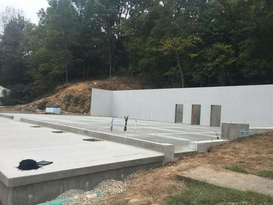 The foundations of The Crunch's new facility rise against an embankment in Hardin. The expansion will allow the business to diversify its fitness offerings and better serve the community, owner Nate Sagez said. Photo: For The Telegraph