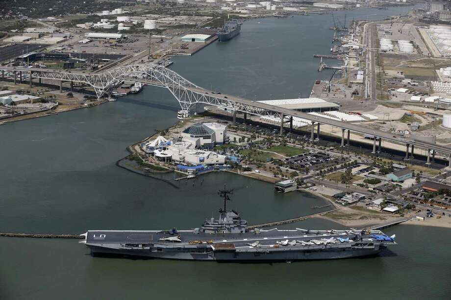 The USS Lexington, the Harbor Bridge and the Texas State Aquarium are seen with the Port of Corpus Christi on Tuesday, Aug. 8, 2017. The U.S. is awash in far more plastic than it needs, so chemical companies along the Gulf Coast are seeking more buyers abroad as production continues to skyrocket. Photo: JERRY LARA /San Antonio Express-News / San Antonio Express-News