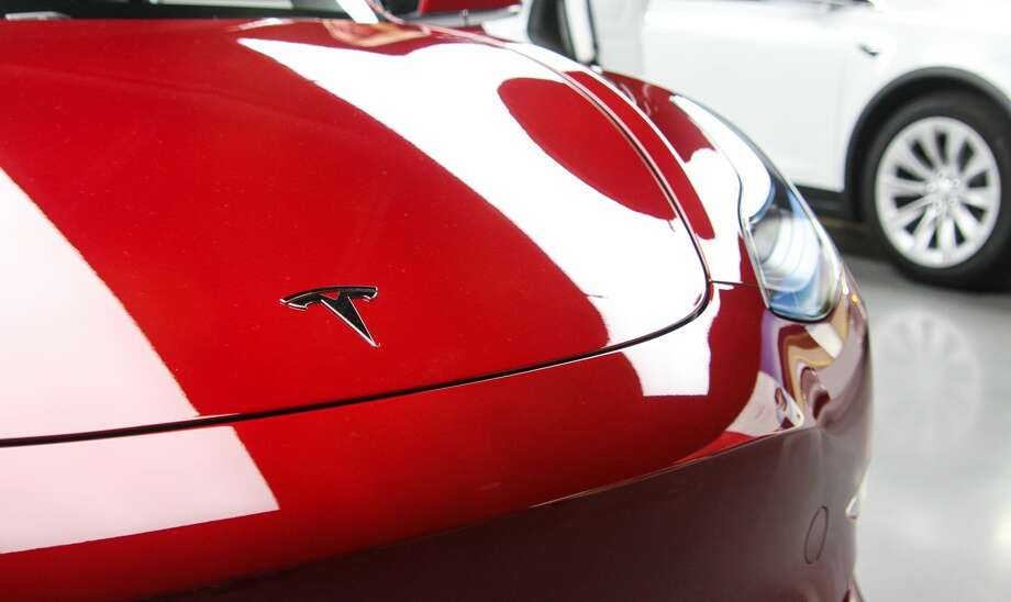 Tesla's newest car, the Model 3, is seen at the Bellevue Square Tesla showroom on Friday, Feb. 9, 2018. Deliveries to customers began in November, but with 450,000 reservations for the most affordable Tesla yet, many who hold reservations are still waiting for their cars. Photo: DANIEL DEMAY / SEATTLEPI.COM