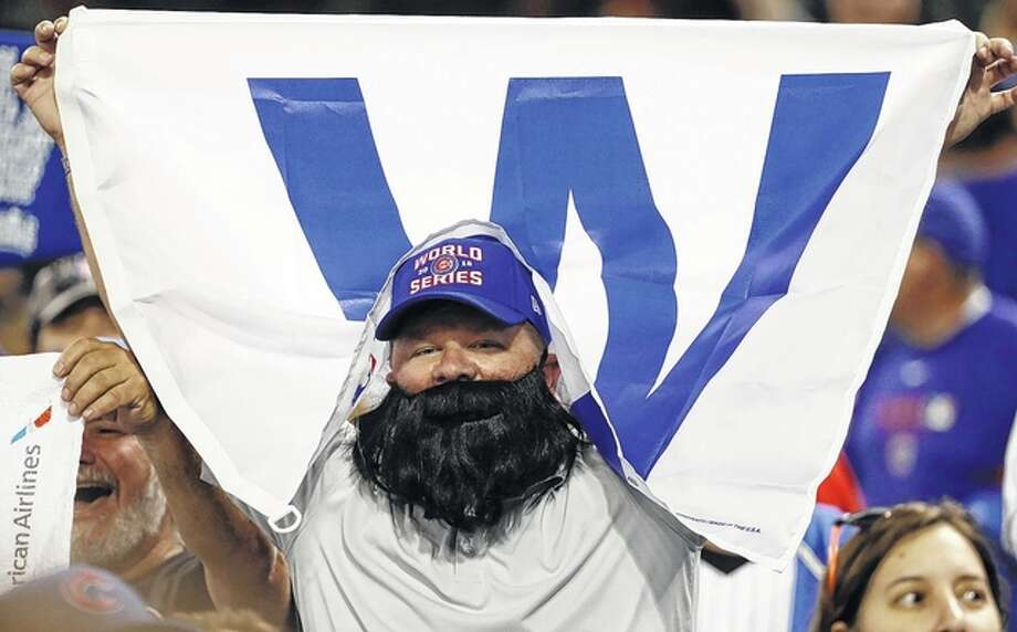 A Chicago Cubs fan cheers at Progressive Field after Game 6 of the Major League Baseball World Series against the Cleveland Indians Tuesday in Cleveland. The Cubs won 9-3 to tie the series 3-3. David J. Phillip | AP Photo