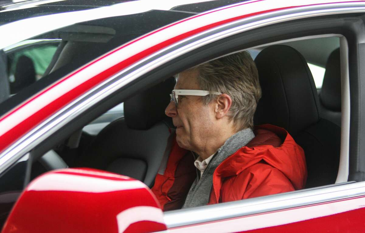 Christian Grevstad tours the driver's compartment of Tesla's new Model 3 at the company's Bellevue Square showroom on Friday, Feb. 9, 2018. Deliveries to customers began in November, but with 450,000 reservations for the most affordable Tesla yet, many who hold reservations are still waiting for their cars.