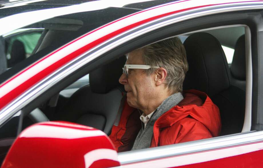 Christian Grevstad tours the driver's compartment of Tesla's new Model 3 at the company's Bellevue Square showroom on Friday, Feb. 9, 2018. Deliveries to customers began in November, but with 450,000 reservations for the most affordable Tesla yet, many who hold reservations are still waiting for their cars. Photo: DANIEL DEMAY / SEATTLEPI.COM