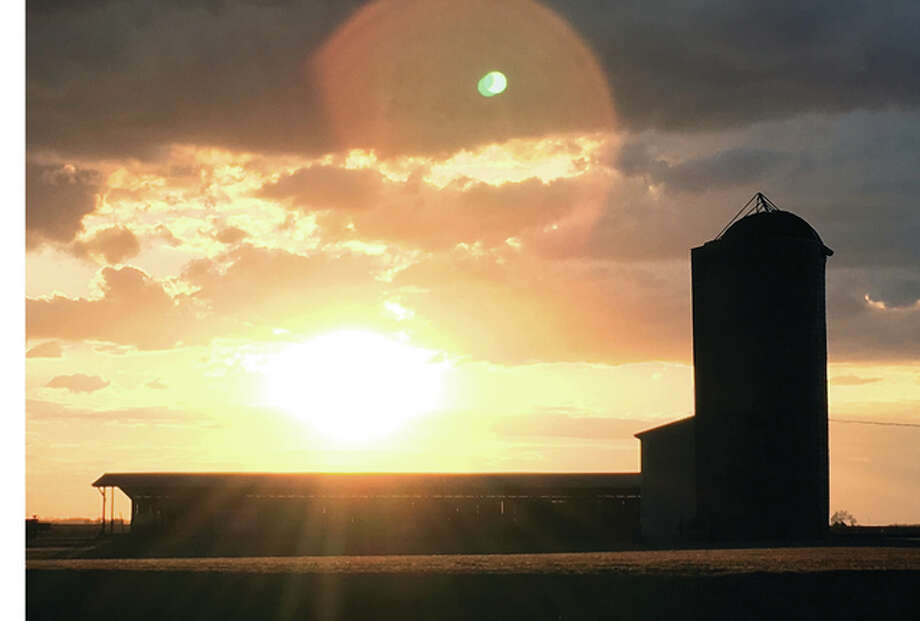 The sun sets over a freshly harvested field north of Greenfield. Photo: Amy Turpin | Reader Photo