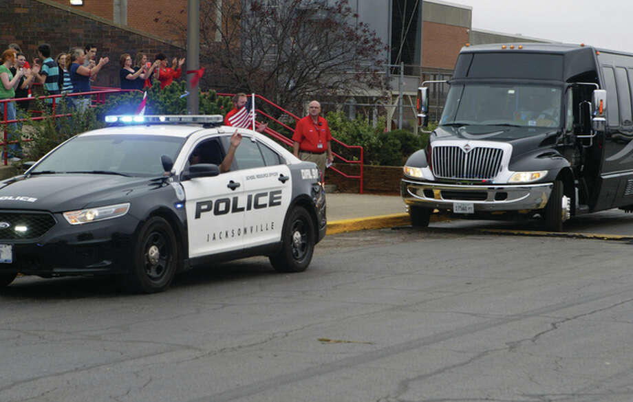 Members of the Jacksonville High School boys soccer team leave with a police escort through town Thursday as they began their journey to the state finals near Chicago. Photo: Samantha McDaniel-Ogletree | Journal-Courier