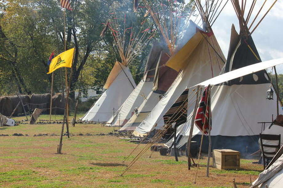 An old Gadsden flag flies in front of a row of tents at a past Old Settlers Days festival. Photo: For The Telegraph