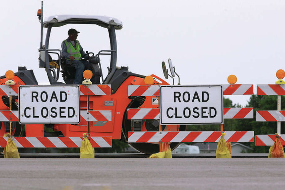 Seth Perlman | AP Road construction crews work to build a four-lane highway in Edinburg. The first question on Illinois ballots isn't for president, senator or comptroller, but a constitutional amendment geared toward preventing transportation-related funding from being used elsewhere. Backers include unions and the construction industry.
