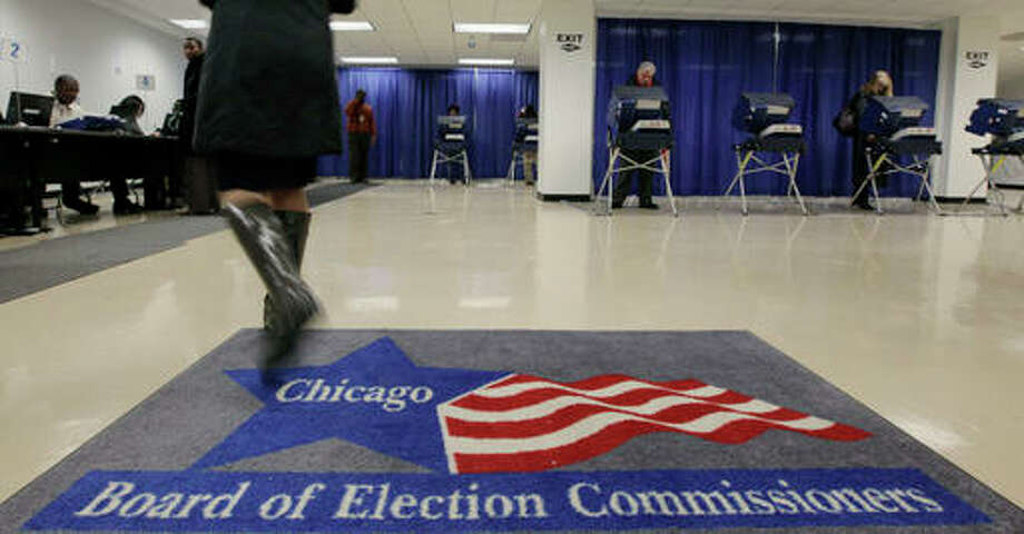 In this Jan. 27, 2010 file photo, voters cast their ballots for Illinois' primary at an early voting polling place in Chicago. AP Photo | M. Spencer Green File