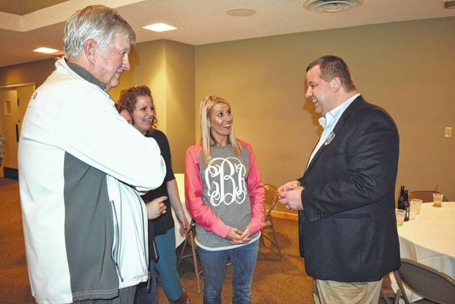 Tom Eoff (from left), Paige Graham and Cortney Bonjean speak with Morgan County State's Attorney Gray Noll Tuesday night at the Jacksonville Elks Club. Noll, a Republican, defeated his Democratic opponent, Tyson Manker, in the race for state's attorney. Photo: Greg Olson | Journal-Courier