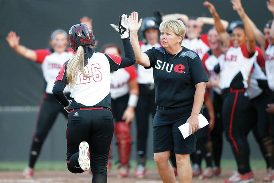 SIUE coach Sandy Montgomery (front) will lead her team into its first action of the fall season Saturday with games against Wash U. and Saint Louis U in St. Louis. The cougars will play a pair of games Sunday at home. Montgomery is shown celebrating a home run with her team during a previous season. Photo: SIUE Athletics File Photo