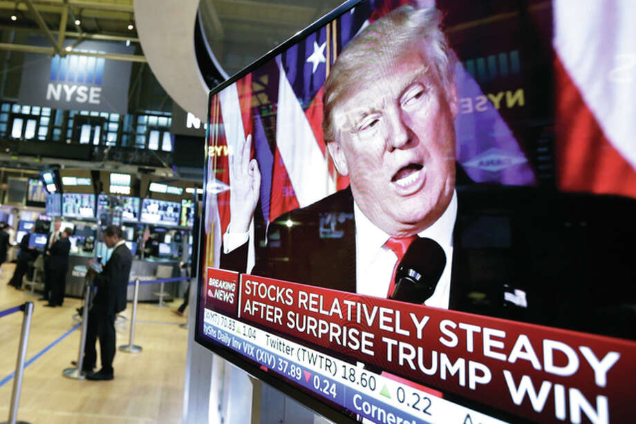 Richard Drew | AP An image of President-elect Donald Trump appears on a television screen on the floor of the New York Stock Exchange on Wednesday. Stocks were moving solidly higher in midday trading on Wall Street following Trump's upset victory over Hillary Clinton in the U.S. presidential election.