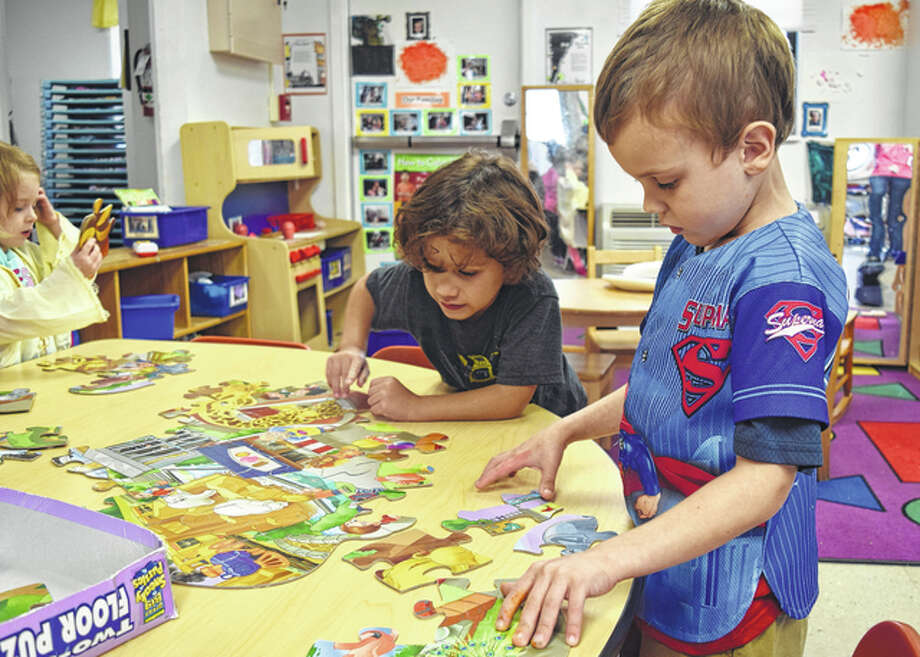 Early Years Program students Noah Lopez (left), 4, and Ace Deloach, 5, work on a puzzle during free time Wednesday. Photo: Nick Draper | Journal-Courier