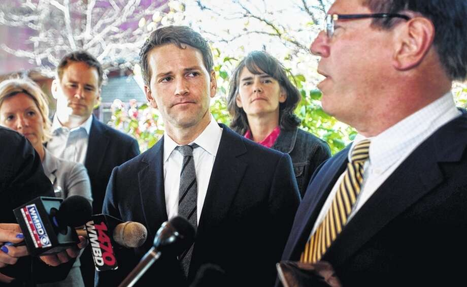 Former U.S. Rep. Aaron Schock, center, and members of his family listen as attorney Jeff Lang, right, speaks during a press conference Thursday outside Peoria Heights Village Hall in Peoria Heights. Schock's defense team said Thursday that the former congressman, who resigned amid scrutiny of lavish spending, expects to be indicted by a federal grand jury. Matt Dayhoff   Journal Star via AP