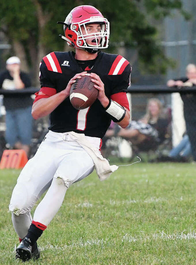 Calhoun quarterback Ty Bick threw three touchdown passes and ran for a 49-yard touchdown in his team's 49-14 victory over West Central Friday. He is shown in action earlier this season. Photo: Bonnie Snyders | For The Telegraph