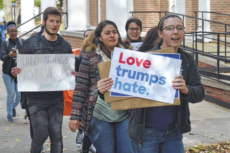 "Students walk through the Illinois College campus Friday chanting ""love trumps hate"" in opposition to President-elect Donald Trump. Photo: Nick Draper 