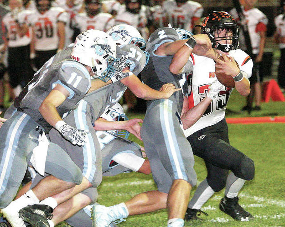 A host of Jerseyville Panthers join in to push Waterloo's Dalton Viglasky out of bounds as the Bulldogs drive early in the fourth guarter.