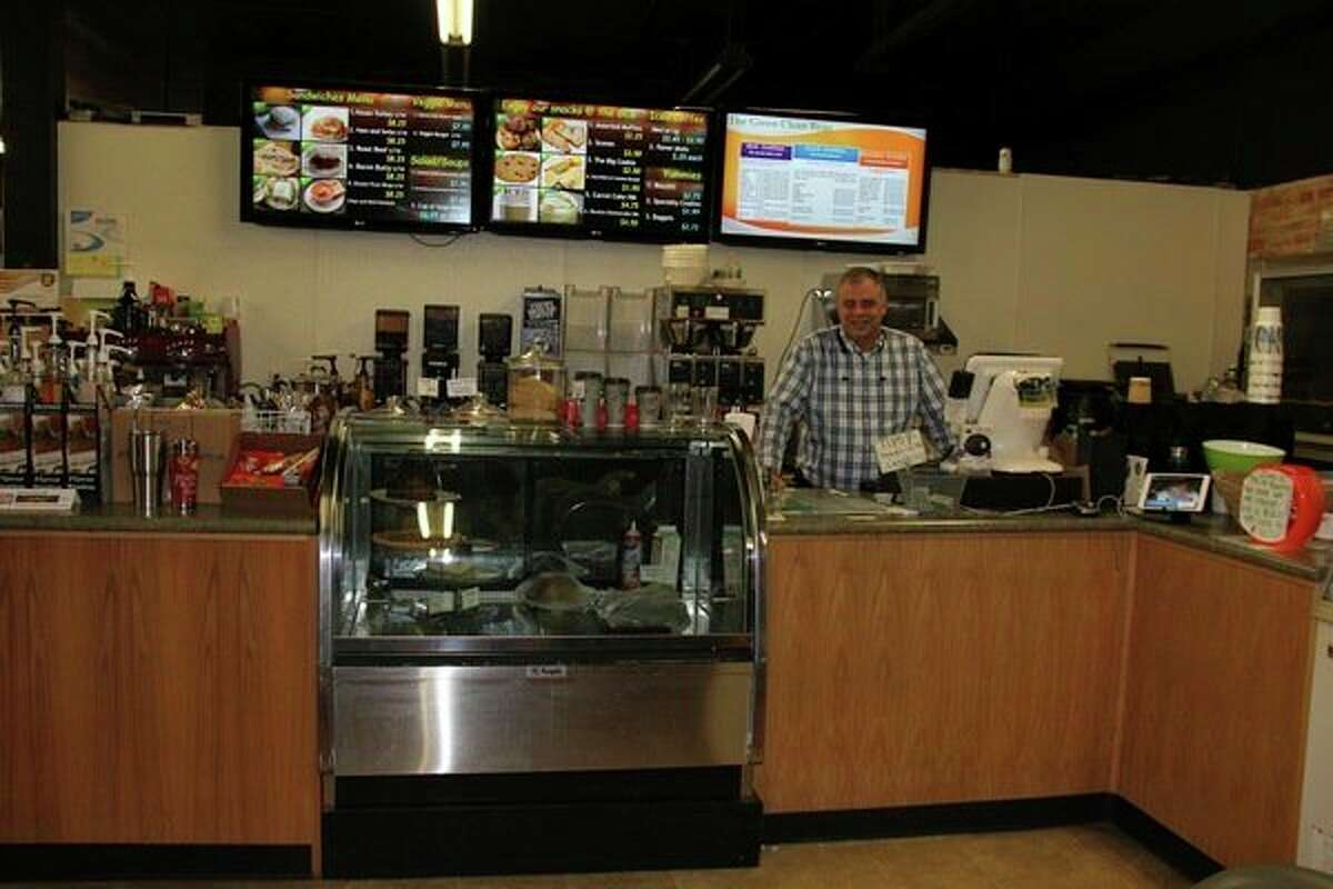 Dean Avola, owner of Green Clean Bean, stands behind the coffee counter of his business in downtown Bad Axe. The business also has pool tables, wireless internet access and a laundromat. (Chip Burch/Huron Daily Tribune)