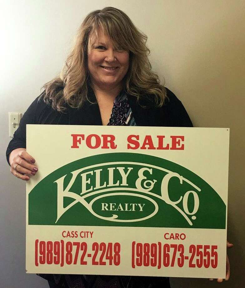Joey Kreeger of Kelly & Co. Realty manages the company's recently-opened Caro location. (Brenda Battel/Huron Daily Tribune)