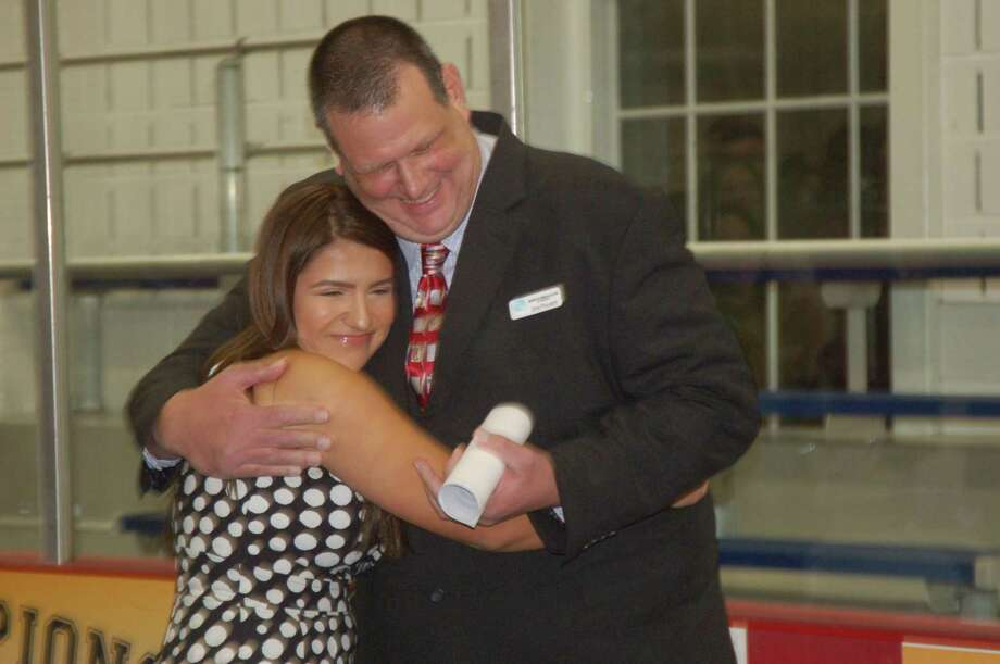 Youth of the Year winner Domenica Echeverria got a congratulatory hug by Boys and Girls Club of Greenwich Director of Programs Don Palmer after her win was announced Thursday night. Photo: Ken Borsuk