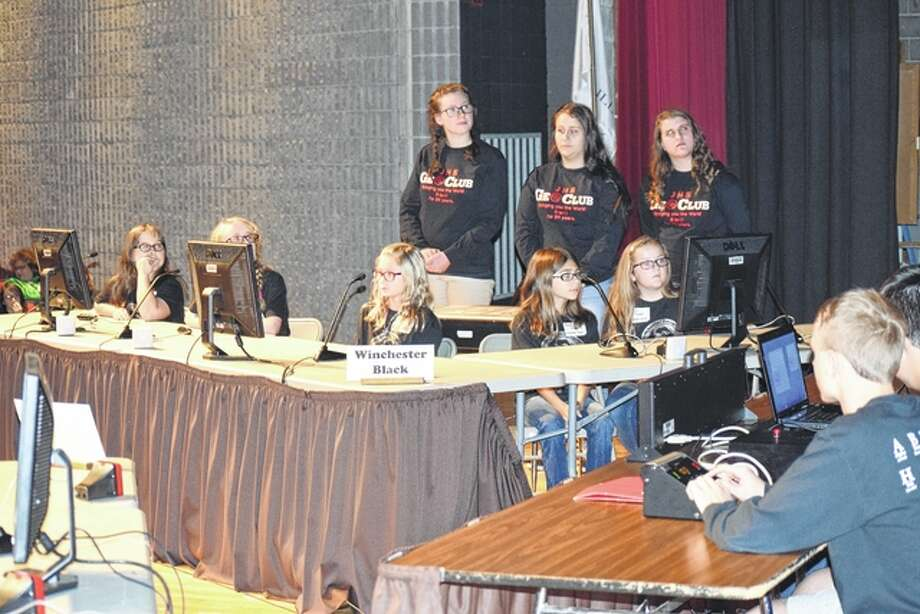 Winchester Elementary School's black team competes against North Jacksonville Elementary School's red team Wednesday night in the 24th Regional Geography Bowl at the Jacksonville High School auditorium. Photo: Greg Olson | Journal-Courier