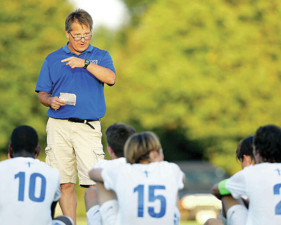 Marquette Catholic High boys soccer coach Joe Burchett's team will start the playoffs Oct. 10 against either Metro East Lutheran or Lebanon in the semifinal of their own Marquette Class 1A Regional Tournament. Above, Burchett addresses his team during halftime of n earlier game. Photo: Billy Hurst File Photo   For The Telegraph