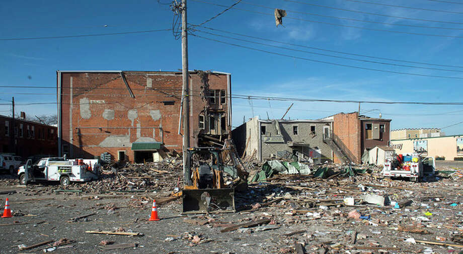 David Zalaznik | Journal Star (AP) Debris is scattered Thursday at the site of a natural gas explosion in Canton. Authorities are investigating the cause of the explosion Wednesday that rocked downtown houses and businesses, shattering glass and cracking interior walls in nearby buildings.