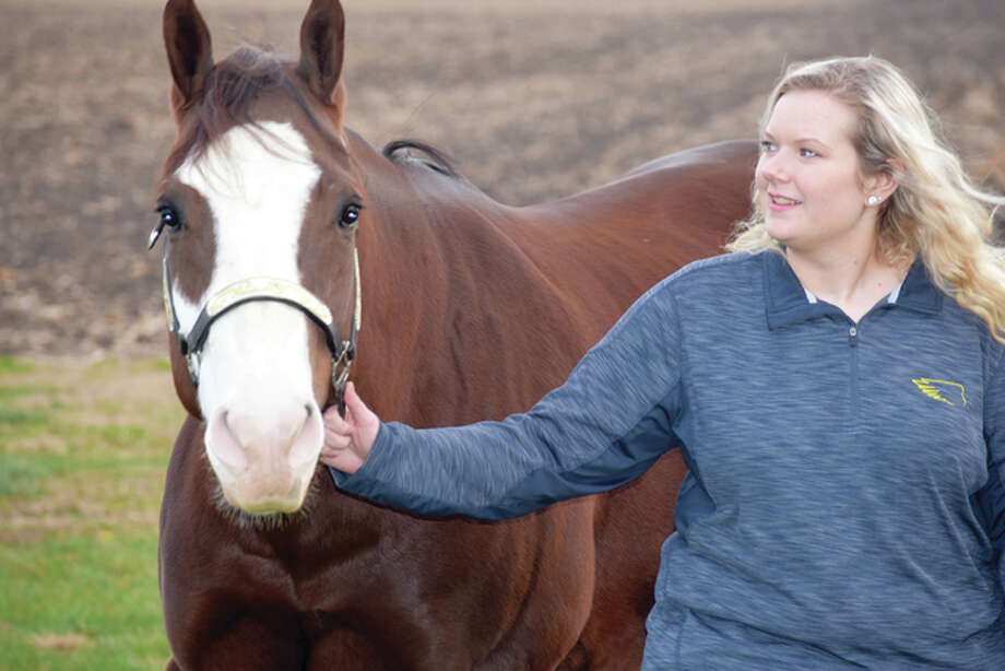 Erin Lakamp of New Berlin takes a walk with her 8-year-old quarter horse, Mac. Photo: Nick Draper | Journal-Courier