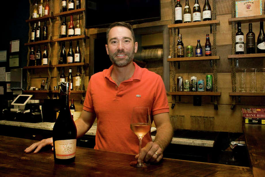 Dr. Chris Aldridge, the president of Solera Wines, stood in the wine bar Friday as he prepared to open. With a growing selection of more than 120 wines, the business offers one of the most diverse wine selection in the Riverbend. Photo: Alex Heeb|The Telegraph