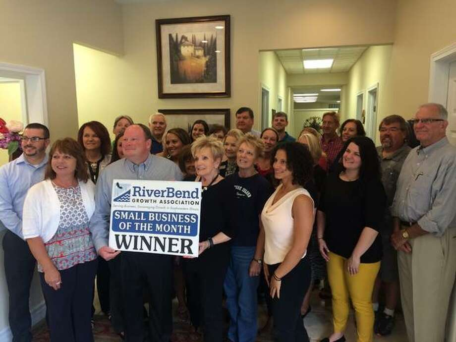 """Owners Dennis Dugan and Sharon Pratt, employees and local dignitaries gathered Thursday as Re/Max Riverbend was honored as the RiverBend Growth Association's Small Business of the Month. """"We are very honored to have this award,"""" Pratt said."""