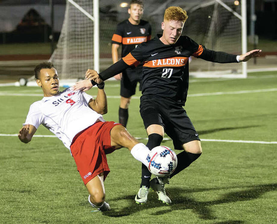 SIUE's Devyn Jambga (left) beats Bowling Green's Zach Buescher to the ball during the Cougars' 3-1 Homecoming victory before a crowd of nearly 4,000 at Korte Stadium in Edwardsville. It was SIUE soccer's first match as a member of the Mid-American Conference. Photo: SIUE Athletics
