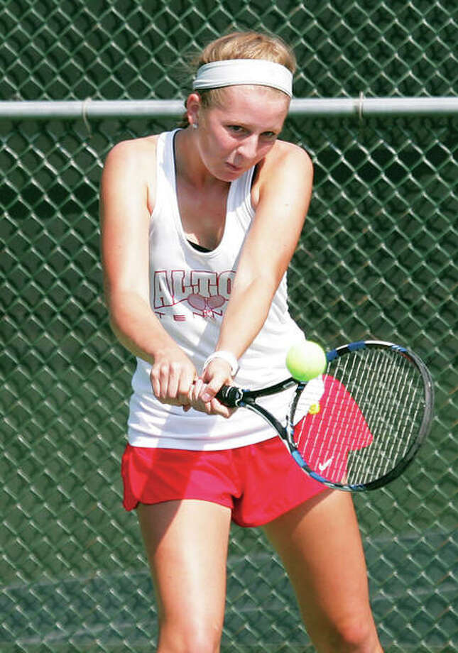 Alton's Abby Fischer returns the ball during play in the No. 1 singles bracket in a tournament earlier this season at LCCC's Andy Simpson Tennis Complex in Godfrey. Fischer was at Edwardsville on Saturday and place fourth at No. 1 singles in the Southwestern Conference Tournament. Photo: James B. Ritter / For The Telegraph